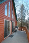 Cabin at the lake exterior front deck med02